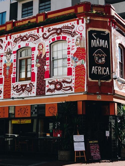 "Restaurant facade with ""MAMA AFRICA"" above the door"