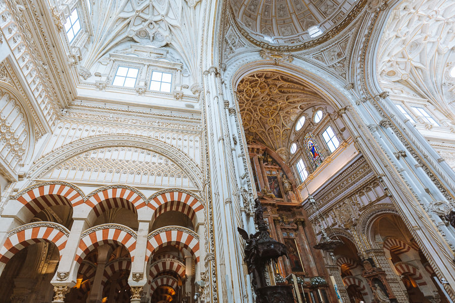 Intricate Christian designs with tall vaulted ceilings inside the Cordoba Cathedral