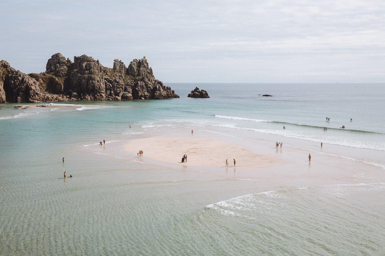 large beach with a sandbar and lagoon pool